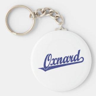 Oxnard script logo in blue distressed basic round button keychain