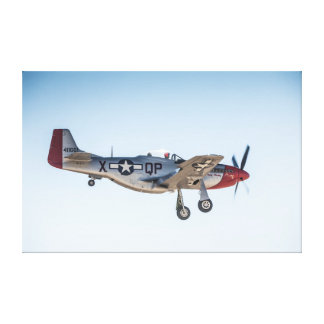 P51-D Mustang doing a flypast against a blue sky Canvas Print