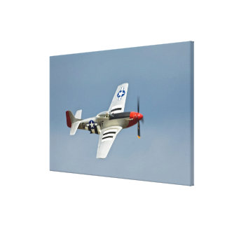 P-51D Mustang Fighter with D-Day markings flying Canvas Print