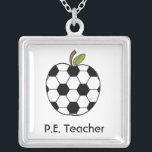 """P.E. Teacher Necklace - Soccer Ball Apple<br><div class=""""desc"""">A necklace for physical education teachers featuring a soccer ball apple.  Text underneath reads &quot;P.E. Teacher.&quot;</div>"""