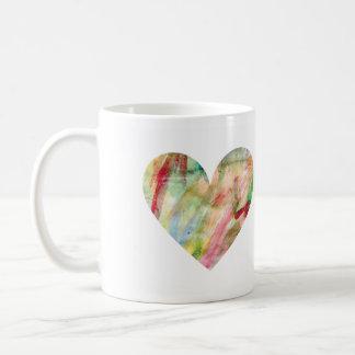 P.M. de la taza del corazón del arco iris de la