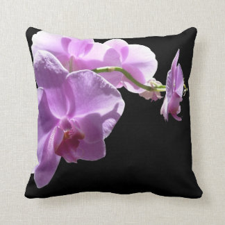 © P Wherrell Pink orchid on black background Throw Pillows