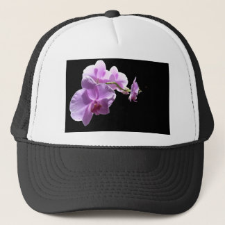 © P Wherrell Pink orchid on black background Trucker Hat