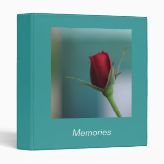 © P Wherrell Pretty red rose on turquoise binder