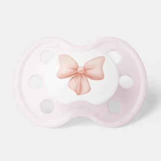 Pacificador rosado del arco chupetes de bebe