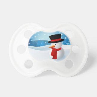 Pacificadores lindos del muñeco de nieve chupetes