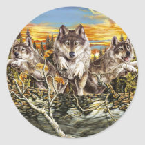 Pack of wolves running classic round sticker