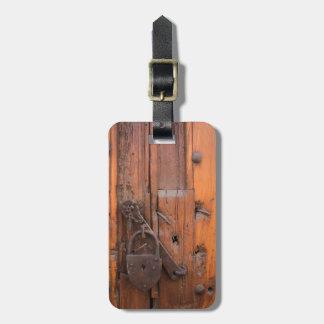 Padlock on wooden door bag tag
