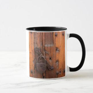 Padlock on wooden door mug