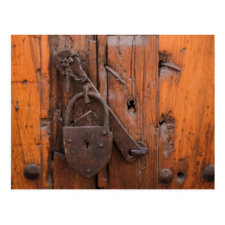 Padlock on wooden door postcard
