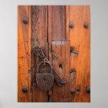 Padlock on wooden door poster