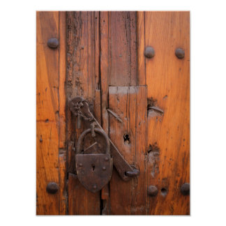 Padlock on wooden door poster