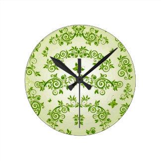 padrão com formas de caracol em verde round clock
