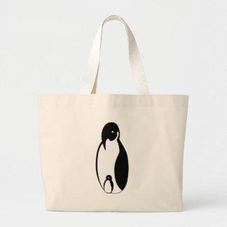 Padre y polluelo oblongos del pingüino bolsas