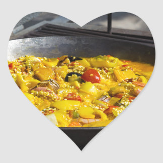 Paella is cooked on a grill heart sticker