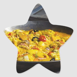 Paella is cooked on a grill star sticker