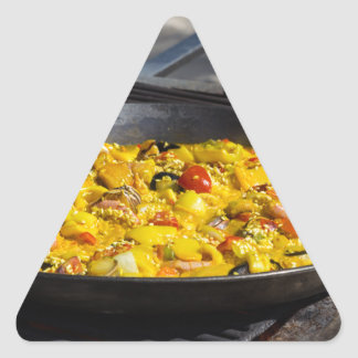 Paella is cooked on a grill triangle sticker