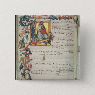 Page of musical notation with a historiated button