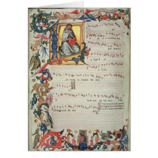 Page of musical notation with a historiated card