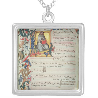Page of musical notation with a historiated necklace