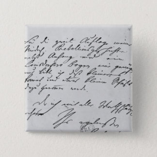 Page of text with his signature pinback button