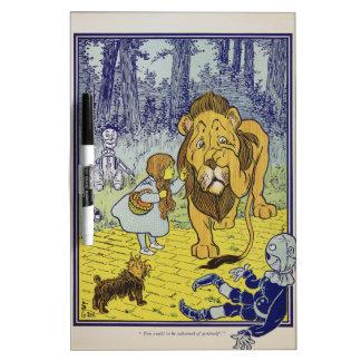 Página cobarde del libro de mago de Oz del león Pizarras Blancas