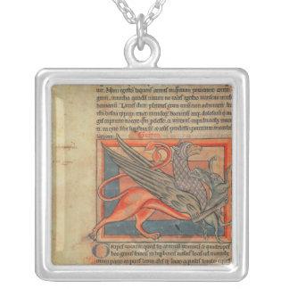Página del texto con un ejemplo de un grifo collar plateado