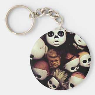 Painted baby doll heads keychain