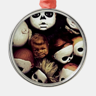 Painted baby doll heads metal ornament