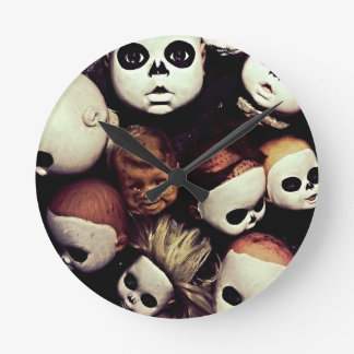 Painted baby doll heads round clock