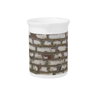 Painted brick wall pitcher