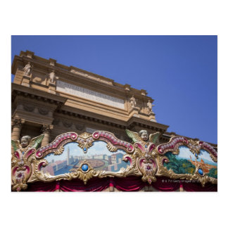 painted decorative carousel with pictures of postcard