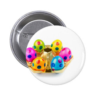 Painted easter eggs in gold tray isolated on white button