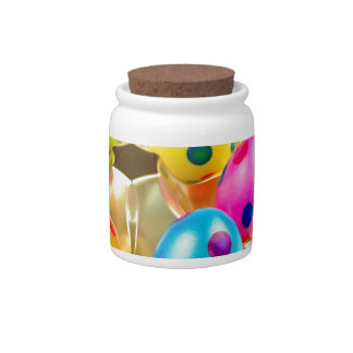 Painted easter eggs in gold tray isolated on white candy jar