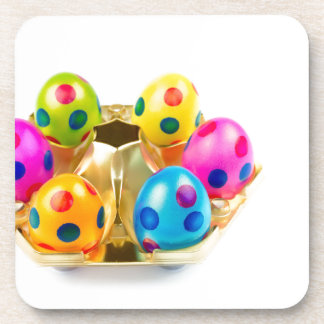 Painted easter eggs in gold tray isolated on white coaster