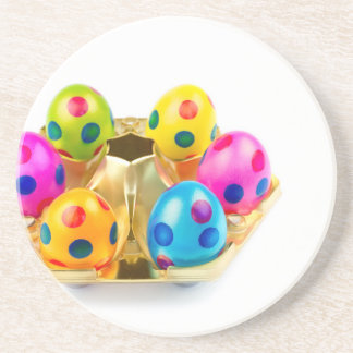 Painted easter eggs in gold tray isolated on white drink coaster
