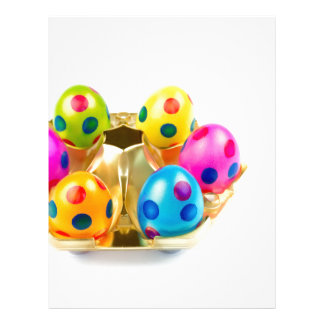 Painted easter eggs in gold tray isolated on white letterhead