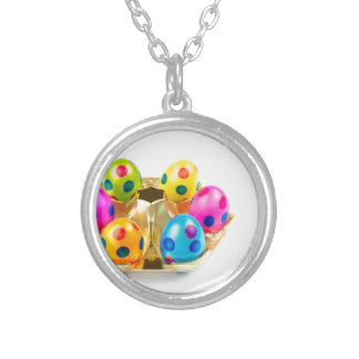 Painted easter eggs in gold tray isolated on white silver plated necklace