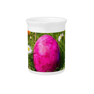 Painted easter eggs in grass with daisies beverage pitcher