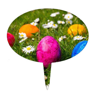 Painted easter eggs in grass with daisies cake topper
