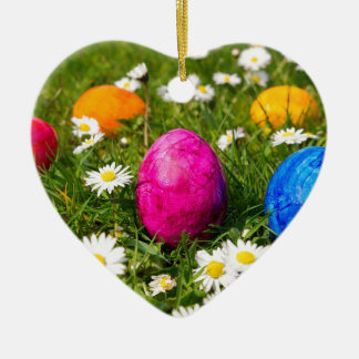 Painted easter eggs in grass with daisies ceramic ornament