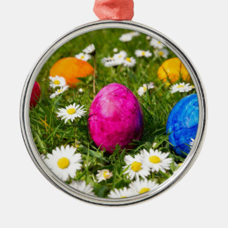 Painted easter eggs in grass with daisies metal ornament