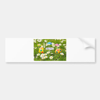 Painted Easter eggs in grass with white daisies Bumper Sticker