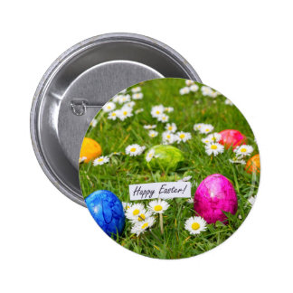 Painted Easter eggs in grass with white daisies Button