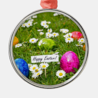 Painted Easter eggs in grass with white daisies Metal Ornament