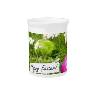 Painted Easter eggs in grass with white daisies Pitcher