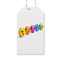 Painted easter eggs in row on white background gift tags