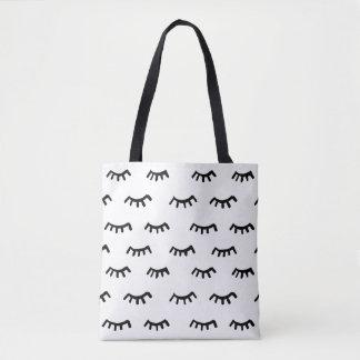 painted eyelashes black and white tote bag