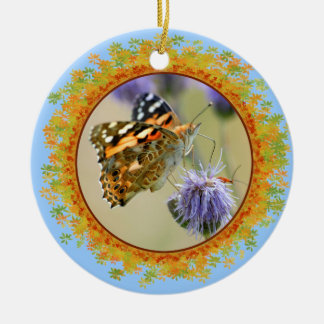 Painted lady butterfly feeding in frame of leaves ceramic ornament