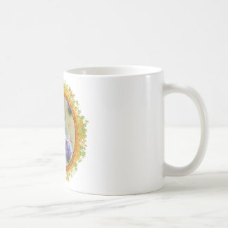 Painted lady butterfly feeding in frame of leaves mugs